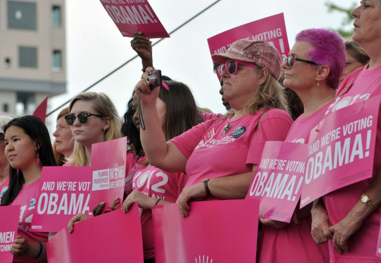 Supporters of Planned Parenthood shout slogans and wave banners during a rally in support of US president Barack Obama in Charlotte, North Carolina, September 4, 2012 ahead of the opening of the DNC. (Mladen Antonov/AFP/Getty Images)