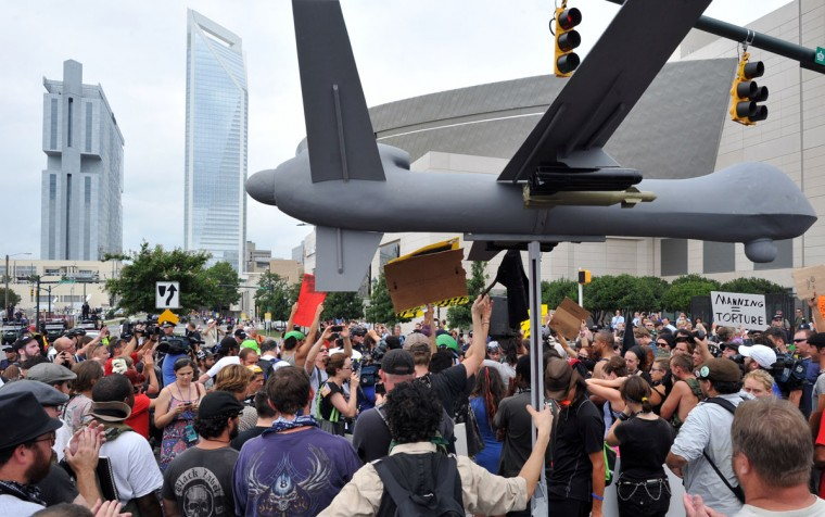 Protesters carry a replica of military drone plane during a demonstration in Charlotte, North Carolina, September 4, 2012 ahead of the opening of the Democratic National Convention. (Mladen Antonov/AFP/Getty Images)
