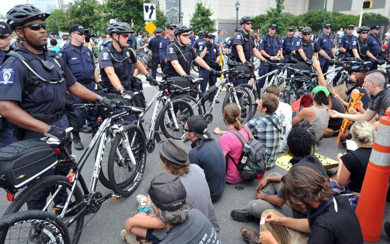 Protesters sit on the ground in protest during a demonstration in Charlotte, North Carolina, September 4, 2012 ahead of the opening of the Democratic National Convention. (Mladen Antonov/AFP/Getty Images)