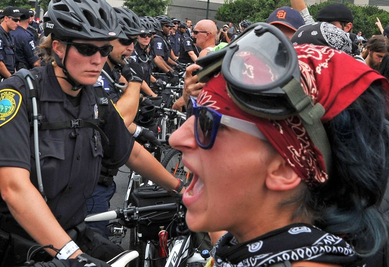 A protester confronts a police officer during a demonstration in Charlotte, North Carolina, September 4, 2012 ahead of the opening of the Democratic National Convention. (Mladen Antonov/AFP/Getty Images)