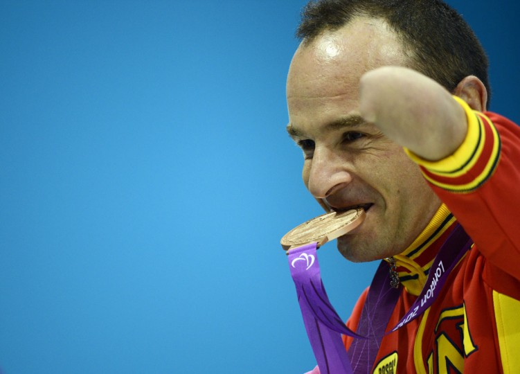 Spain's Ricardo Ten celebrates with his bronze medal after the Men's 100 metres Breaststroke Final SB4 category during the London 2012 Paralympic Games at the Aquatics Centre in the Olympic Park in east London on September 4, 2012. (Adrian Dennis/AFP/Getty Images)