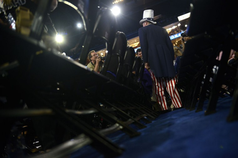 Tim Kubik smiles for photographers at the Time Warner Cable Arena in Charlotte, North Carolina, on September 4, 2012 before the start of the first day of the Democratic National Convention (DNC). (Brendan Smialowski/AFP/Getty Images)