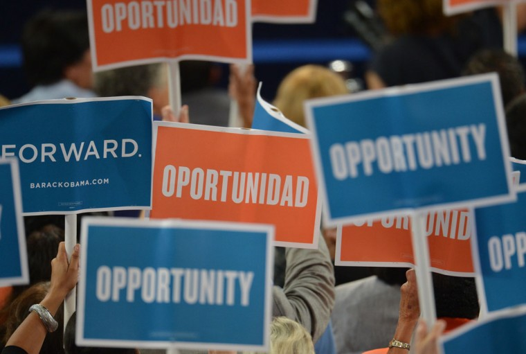 Supporters wave signs as San Antonio Mayor Julian Castro speaks to the audience at the Time Warner Cable Arena in Charlotte, North Carolina, on September 4, 2012 on the first day of the Democratic National Convention (DNC). (Stan Honda/AFP/Getty Images)