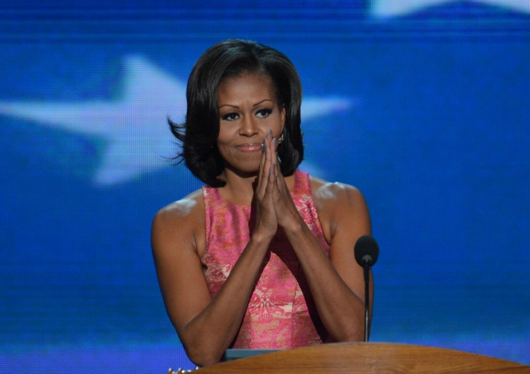 First Lady Michelle Obama acknowledges the crowd at the Time Warner Cable Arena in Charlotte, North Carolina, on September 4, 2012 on the first day of the Democratic National Convention (DNC). (Stan Honda/AFP/Getty Images)