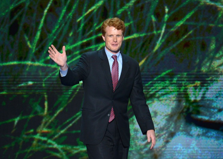 Joe Kennedy III, candidate for the U.S. House of Representatives, Massachusetts, waves to the audience at the Time Warner Cable Arena in Charlotte, North Carolina, on September 4, 2012 on the first day of the Democratic National Convention (DNC). (Stan Honda/AFP/Getty Images)