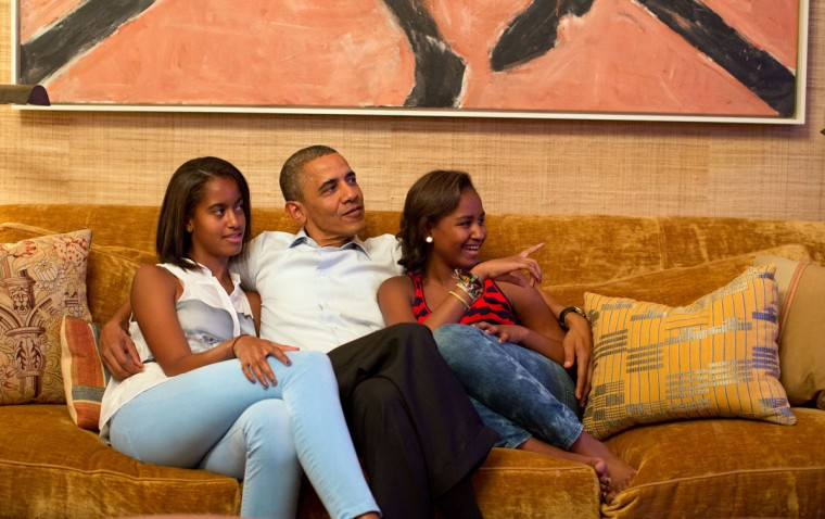 U.S. President Barack Obama and his daughters, Malia (L) and Sasha watch as U.S. First Lady Michelle Obama takes the stage to deliver her speech at the Democratic National Convention in Charlotte, North Carolina. (Pete Souza/White House Photo)