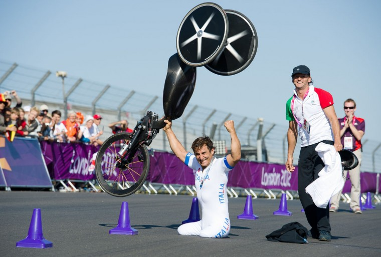 Italy's Alessandro Zanardi celebrates after winning the gold medal in the men's individual H4 time trial cycling final during the London 2012 Paralympic Games at Brands Hatch circuit, in Kent, southern England on September 5, 2012. (Leon Neal/AFP/Getty Images)