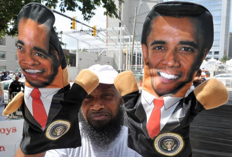A street vendor sells dolls depicting US President Barack Obama outside the Convention Center in Charlotte, North Carolina. (Mladen Antonov/AFP/Getty Images)