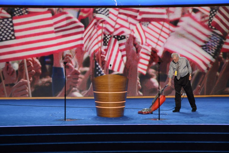 A man vacuums the stage at the Time Warner Cable Arena in Charlotte, North Carolina ahead of events on the second day of the Democratic National Convention (DNC). (Stan Honda/AFP/Getty Images)