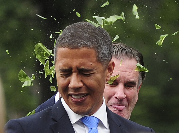 "US Presidential candidate Mitt Romney impersonator Mike Cote (Right) smashes a fake glass bottle over the head of US President Barack Obama impersonator Reggie Brown during an Obama vs Romney ""showdown"" in Washington Square Park in New York on September 05, 2012. (Emmanuel Dunand/AFP photo)"