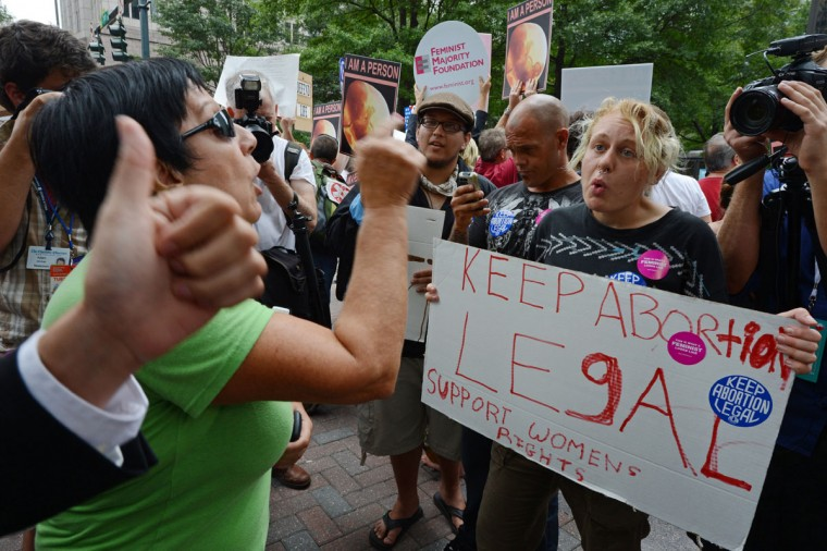 Abortion rights activist Jessica, 22, from New Jersey argues with local resident Adriana Howard (L), about whether or not taxpayer money should be used for abortions, during a protest on day two of the Democratic National Convention (DNC), in Charlotte, North Carolina. (Robyn Beck/AFP/Getty Images)