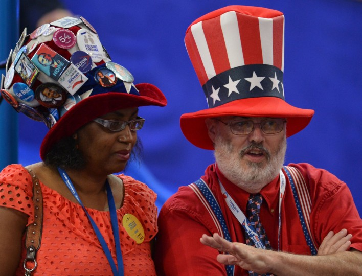 Supporters pose for a group shot at the Time Warner Cable Arena in Charlotte, North Carolina ahead of events on the second day of the Democratic National Convention (DNC). (Stan Honda/AFP/Getty Images)