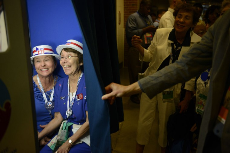 Priscilla Marquez and Evie Walls from Arizona pose in the Google photo booth at the Time Warner Cable Arena in Charlotte, North Carolina ahead of events on the second day of the Democratic National Convention (DNC). (Brendan Smialowski/AFP/Getty Images)