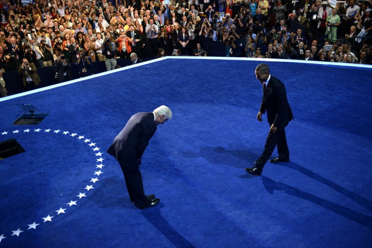 The 42nd President of the United States Bill Clinton (L) bows to the 44th President of the United States Barack Obama at the Time Warner Cable Arena in Charlotte, North Carolina, on September 5, 2012 on the second day of the Democratic National Convention (DNC). (Brendan Smialowski/AFP/Getty Images)