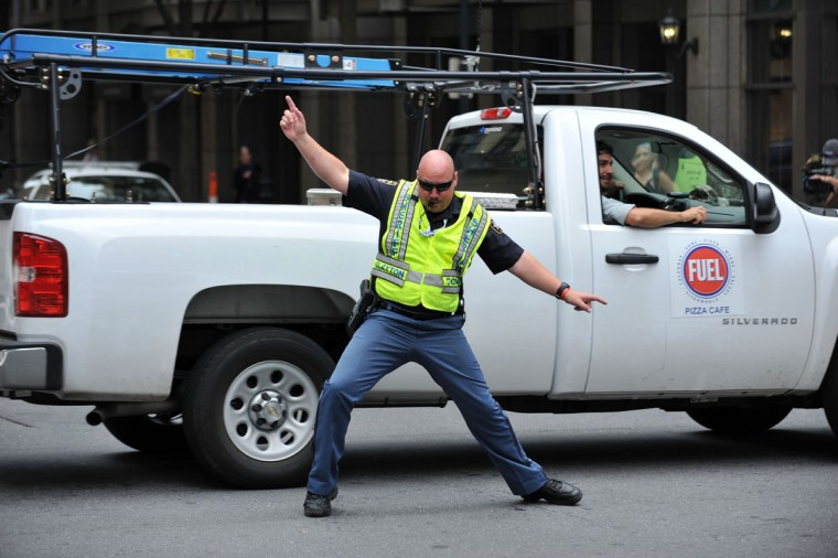 Sheriff Michael Johnson of Clayton County, Georgia directs traffic at the corner of West 5th Street and North Tryon Street near the Time Warner Cable Arena September 6, 2012 in Charlotte, North Carolina on the final day of the 2012 Democratic National Convention. (Stan Honda/AFP/Getty Images)