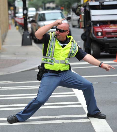 Sheriff Michael Johnson of Clayton County, Georgia directs traffic at the corner of West 5th Street and North Tryon Street near the Time Warner Cable Arena September 6, 2012 in Charlotte, North Carolina on the final day of the 2012 Democratic National Convention. Johnson and his fellow sheriffs use humor in their moves as they direct traffic and pedestrians. (Stan Honda/AFP photo)