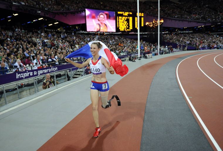 France's Marie-Amelie le Fur celebrates her silver medal in the women's 200m T44 final during the athletics competition at the London 2012 Paralympic Games at the Olympic Stadium in east London on September 6, 2012. (Glyn Kirk/AFP/Getty Images)