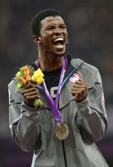 Richard Browne of the US celebrates with his silver medal after coming second in the men's 100m T44 during the athletics competition at the London 2012 Paralympic Games at the Olympic Stadium in east London on September 6, 2012. (Adrian Dennis/AFP/Getty Images)