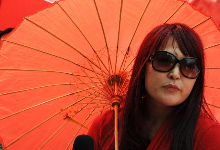 A supporter of the Scarlet Alliance, Australian Sex Workers Association, attends a red umbrella protest rally demanding better service from local council candidates outside the New South Wales parliament. (Greg Wood/AFP/Getty Images)