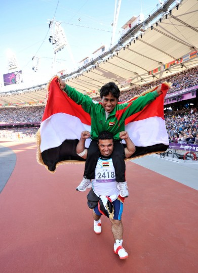 Iraq's silver medalist Ahmed Naas (Above) and compatriot bronze medalist Wildan Nukhailawi (Below) celebrate their medals together after competing in the men's javelin F40 Final in the athletics competition at the London 2012 Paralympic Games at the Olympic Stadium in east London, on September 7, 2012. (Glyn Kirk/AFP/Getty Images)