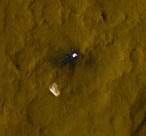 September 6, 2012: This color view of the parachute and back shell that helped deliver NASA's Curiosity rover to the surface of the Red Planet was taken by the High-Resolution Imaging Science Experiment (HiRISE) camera on NASA's Mars Reconnaissance Orbiter. The area where the back shell impacted the surface is darker because lighter-colored material on the surface was kicked up and displaced. (NASA/JPL-Caltech/Univ. of Arizona/HO/AFP/Getty Images)