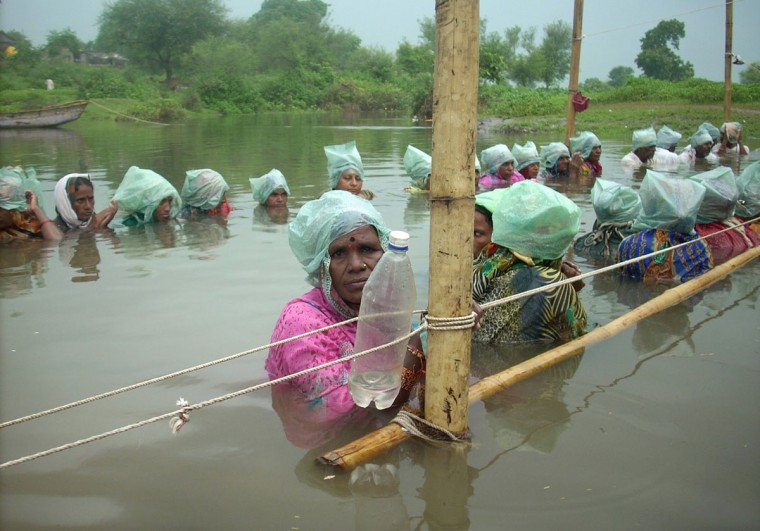 Villagers stand in neck-deep water in protest against the state government's move to increase water levels of regional dams causing flooding of their farmland, at Khandwa village of the central Indian state of Madhya Pradesh. The demonstrators claim that over 1,000 acres of land are already submerged with another 60 villages threatened to be submerged if the water level in the Omkareshwar dam is increased further. (AFP/Getty Images)