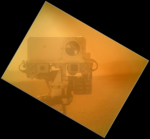 September 7, 2012: The Curiosity rover uses a camera located on its arm to obtain this self portrait. The image of the top of Curiosity's Remote Sensing Mast, showing the Mastcam and Chemcam cameras, was acquired by the Mars Hand Lens Imager (MAHLI). (NASA/JPL-Caltech/Malin Space Science Systems/HO/AFP/Getty Images)