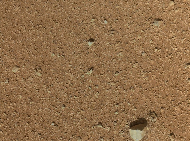September 8, 2012: The reclosable dust cover on Curiosity's Mars Hand Lens Imager (MAHLI) was opened for the first time during the 33rd Martian day, or sol, of the rover's mission on Mars, enabling MAHLI to take this image. (NASA/JPL-Caltech/Malin Space Science Systems/HO/AFP/Getty Images)