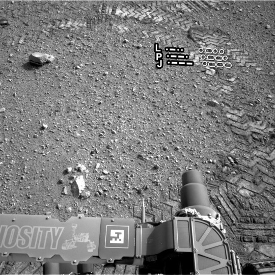 August 28, 2012: A close-up of track marks is shown here from the first test drive of NASA's Curiosity rover on Mars. Instead of a warm, wet and possibly life-bearing planet as some scientists contend, early Mars may have been a hostile and volatile place with frequent volcanic outbursts, a study said on September 9. (NASA/JPL-Caltech/HO/AFP/Getty Images)