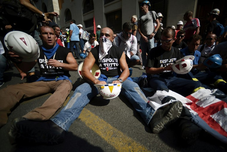 Demonstrators protest against the Alcoa Inc's decision to close Portovesme and Fusina melting plants on the Italian island of Sardinia which employ about 2,000 people. (Filippo Monteforte/AFP/Getty Images)