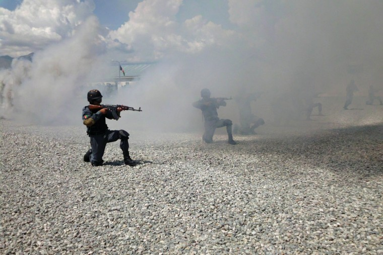 Afghan National Police (ANP) personnel perform a demonstration drill during a graduation ceremony at a police training center in Laghman province on September 10, 2012. NATO countries plan to pull out the bulk of their combat forces by the end of 2014 after a gradual handover to Afghan army and police. (Waseem Nikzad/AFP/Getty Images)