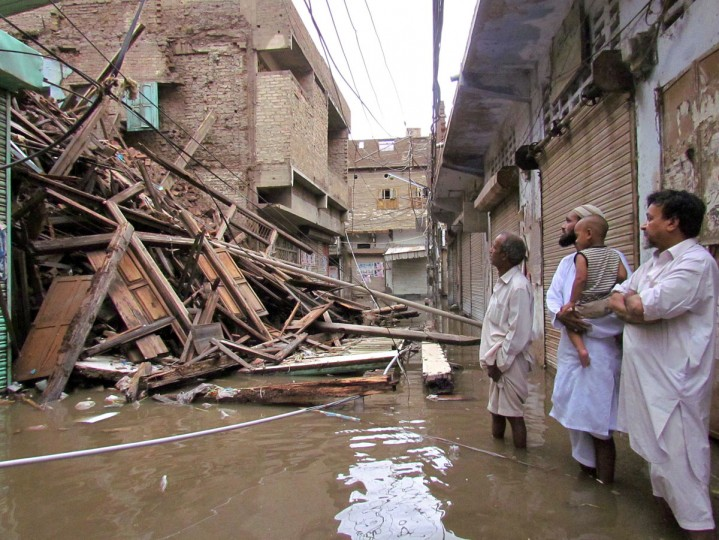 Pakistani residents look at a collapsed house caused by torrential rain in Sukkur on September 10, 2012. At least 78 people have died and dozens more injured in torrential rains and flash floods that have wreaked havoc in Pakistan over the past three days, a government spokesman said Monday. (Stringer/AFP/Getty Images)