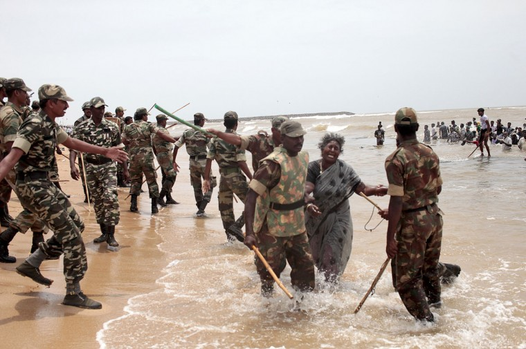 Indian police clash with protestors on the beach at Idinathakarai village near the Kudankulam Nuclear Power Plant in southern Tamil Nadu on September 10, 2012. Police in a southern Indian state shot dead a fisherman and clashed with with activists who were protesting the start of work at a nuclear power plant, officials said. (Stringer/AFP/Getty Images)