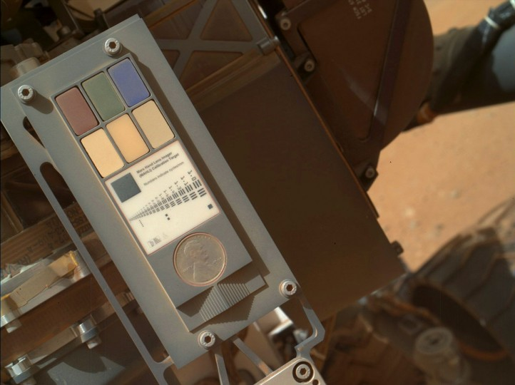 September 9, 2012: This view shows the calibration target for the Mars Hand Lens Imager (MAHLI) aboard NASA's Mars rover Curiosity. The camera is in the turret of tools at the end of Curiosity's robotic arm. Its calibration target is on the rover body near the base of the arm and includes color references, a metric bar graphic, a 1909 VDB Lincoln penny, and a stair-step pattern for depth calibration. (NASA/JPL-Caltech/Malin Space Science Systems/HO/AFP/Getty Images)
