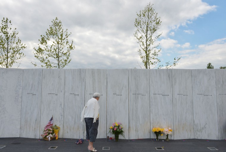A woman looks at flowers at the Flight 93 National Memorial ahead of the 11th anniversary of the 9/11 attacks in Shanksville, Pennsylvania, on September 10, 2012. (Mandel Ngan/Pool/AFP/Getty Images)