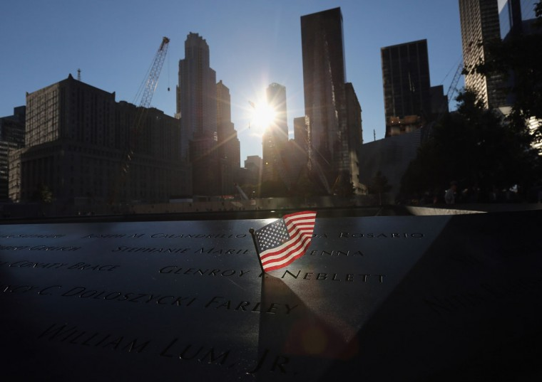 A US flag flies over the 9/11 Memorial before observances on the eleventh anniversary of the attacks on the World Trade Center, at the site on September 11, 2012 in New York. (John Moore/AFP/Getty Images)