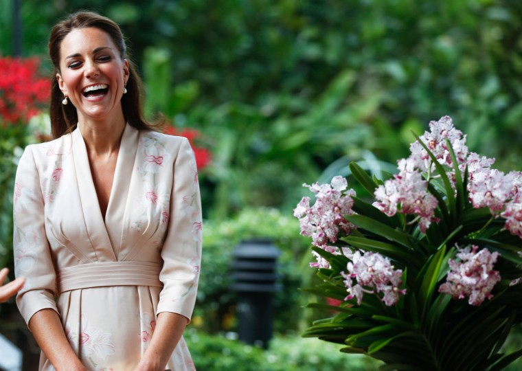 September 11, 2012: Catherine, the Duchess of Cambridge and wife of Britain's Prince William (not pictured), smiles during a ceremony naming a hybrid orchid in their honor at the Orchid Garden within the Singapore Botanical Gardens in Singapore. (Stephen Morrison/AFP/Getty Images)