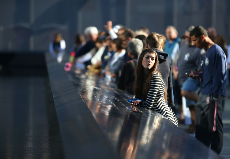 Family members and Friends observe a moment of silence during Commemoration Ceremony of the 11th Anniversary of September 11th by the North Pool at World Trade Center September 11, 2012 in New York. (Chang W. Lee/Pool/AFP/Getty Images)