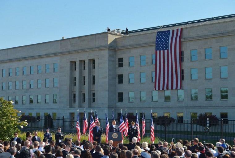 US President Barack Obama(C) speaks during a ceremony commemorating the 11th anniversary of the 9/11 attacks on September 11, 2012 at the Pentagon in Washington, DC. Looking on are Chairman of the Joint Chiefs of Staff Gen Martin Dempsey (R) and US Defense Secretary Leon Panetta (L). (Mandel Ngan/AFP/Getty Images)