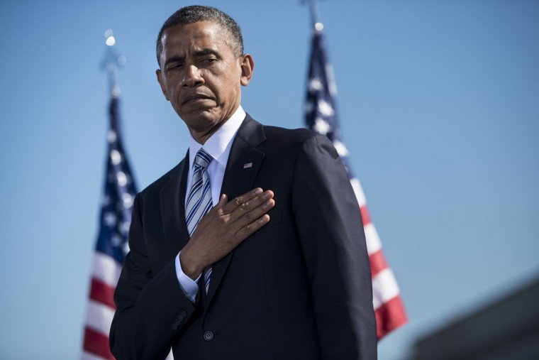 US President Barack Obama listens to the National Anthem during a memorial service at the Pentagon September 11, 2012 in Washington, DC. Obama attended the memorial service near where American Airlines flight 77 was crashed into the Pentagon to honor the victims of the September 11th terrorist attacks on the United States. (Brendan Smialowski/AFP/Getty Images)
