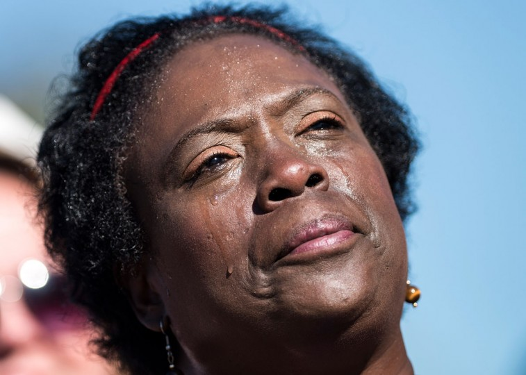 A woman cries as she listens as US President Barack Obama speaks during a memorial service at the Pentagon September 11, 2012 in Washington, DC. (Brendan Smialowski/AFP/Getty Images)