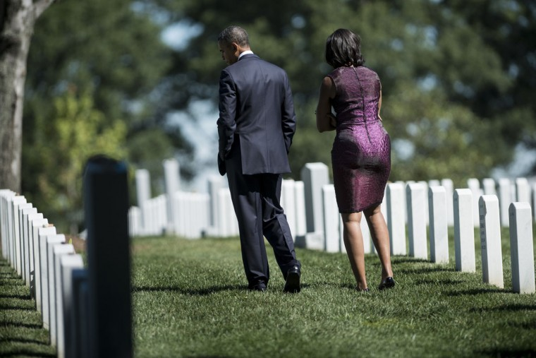 US President Barack Obama and US First Lady Michelle Obama visit graves at Arlington National Cemetery's Section 60 September 11, 2012 in Arlington, Virginia. The Obamas visited the cemetery's Section 60 where many victims of the September 11th terrorist attacks and those who have fought in the wars in Iraq and Afghanistan have been laid to rest. (Brendan Smialowski/AFP/Getty Images)