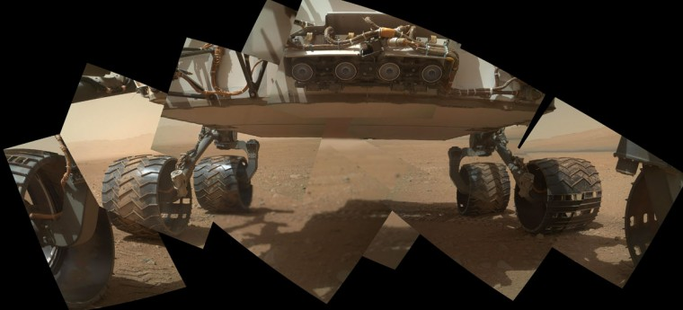 September 9, 2012: This view of the lower front and underbelly areas of NASA's Mars rover Curiosity combines nine images taken by the rover's Mars Hand Lens Imager (MAHLI). Curiosity's front Hazard-Avoidance cameras appear as a set of four blue eyes at the top center of the portrait. (NASA/JPL-Caltech/Malin Space Science Systems/HO/AFP/Getty Images)