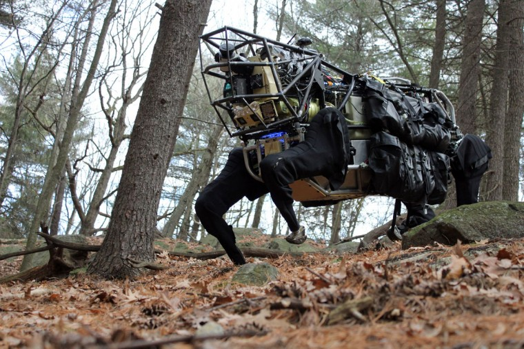 This shows the Legged Squad Support System (LS3) during testing on rough terrain. The LS3 seeks to demonstrate that a highly mobile, semi-autonomous legged robot can carry 400 lbs of a squad'€™s load, follow squad members through rugged terrain and interact with troops in a natural way, similar to a trained animal and its handler. The LS3 program goal is to develop a robot that will go through the same terrain the squad goes through without hindering the squad'€™s mission. The robot could also serve as a mobile auxiliary power source to the squad, so troops can recharge batteries for radios and handheld devices while on patrol. (AFP Photo)