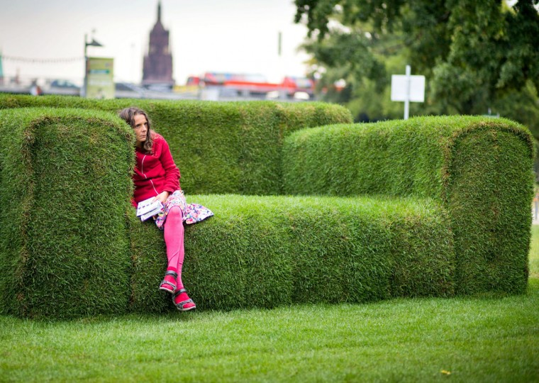 """A woman sits on a grass-made sofa in Frankfurt, western Germany on September 12, 2012. The so-called """"Main-Sofa"""" was initiated by Federal Minister for Environment Puttrich to highlight the upcoming event of the """"Tag der Nachhaltigkeit"""" (Day of Sustainability) on September 19, 2012.(Frank Rumpenhorst/AFP/Getty Images)"""