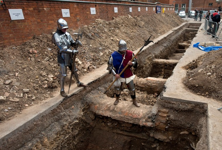 """Men dressed as medieval knights pose for pictures in Leicester in central England, on September 12, 2012, at a site where a skeleton that researchers believe could be British medieval king Richard III was found. Researchers from the University of Leicester said they had found a male skeleton with similarities to historical descriptions of Richard, who ruled England between 1483 and his death in battle in 1485. The remains, which are well preserved, are undergoing DNA analysis. """"What we have uncovered is truly remarkable,"""" said Richard Taylor, the university's director of corporate affairs. (Gavin Fogg/AFP/Getty Images)"""