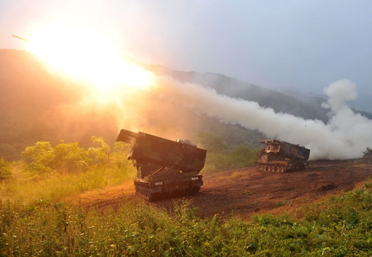 US Multiple Launch Rocket System (MLRS) launch rockets into the air during a live fire training exercise in the South Korean border county of Cheorwon. Some 28,500 US troops are based in South Korea under a mutual defence pact to deter against the North Korean threat. The two Koreas have been technically at war since the conflict ended in an armistice, without a subsequent peace treaty being signed. (Jung Yeon-Je/GettyImages)