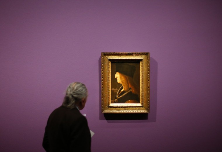 "A spectator looks at an artwork titled ""Maximilian I"" by artist Ambrogio de Predis displayed as part of the exhibition ""Emperor Maximilian 1 and the art of the Albrecht Durer period"" at the Albertina museum in Vienna on September 13, 2012. (Alexander Klein/AFP/Getty Images)"