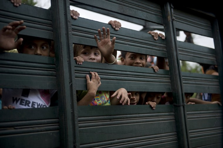 Children ride in the back of an army truck after being evacuated from Morazan in Chimaltenango department, 125 km south of Guatemala City on September 13,2012 after the village was affected by columns of ash released by the Volcan de Fuego. Guatemala's Volcano of Fire had its strongest eruption in a decade on Thursday, prompting the evacuation of around 33 thousand people, officials announced. (Johan Ordonez/AFP/Getty Images)