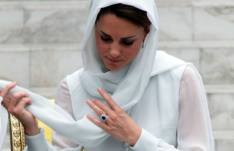 Britain's Prince William's wife Catherine, the Duchess of Cambridge adjusts her scarf outside a mosque at KLCC in Kuala Lumpur, on the second leg of a nine-day Southeast Asian and Pacific tour marking Queen Elizabeth II's Diamond Jubilee. (Saeed Khan/AFP/Getty Images)